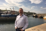 David Duguid standing in fornt of harbour